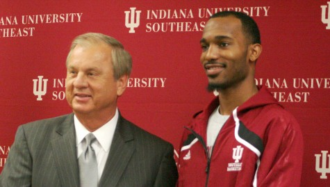 Doug England, mayor of New Albany, stands with Jazzmarr Ferguson, senior guard, at the send-off celebration on March 4.