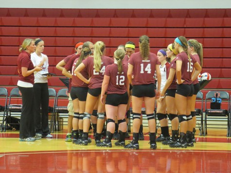 The IU Southeast volleyball team huddles up after a timeout during the fourth set against Oakland City on Thursday night. The Grenadiers lost the match in five sets.