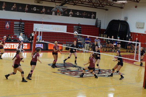 The IU Southeast women's volleyball team scrambles to hit this ball back over the net on senior night against St. Catharine, Oct.30. The Grenadiers lost in straight sets.