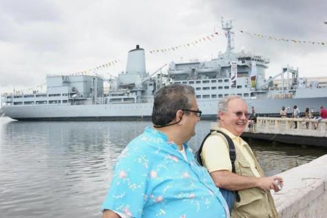Psychology Professor Bernardo J. Carducci (left), and Cliff Staten (right) at a harbor in Cuba.