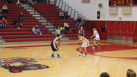 Senior guard, Megan Cureton defends against  a Midway College player on Senior night. Cureton had four steals in the win.
