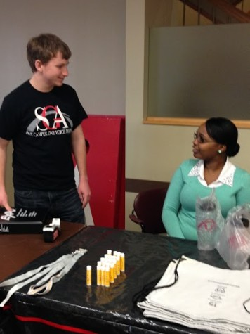 Trent Wallace, SGA president and advertising and communications junior, speaks with Angel Russell, SGA chief justice and sociology junior during the SGA homecoming event on Wednesday, Feb. 11