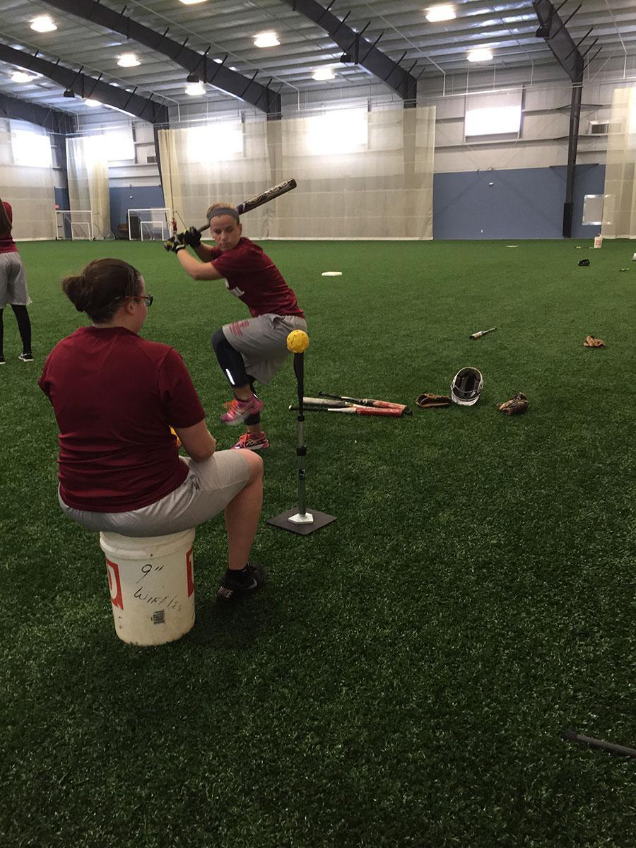 Senior captain Summer Sanders working on her hitting.