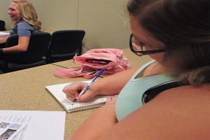 Sarah Mann, psychology sophomore, takes notes at the seminar.