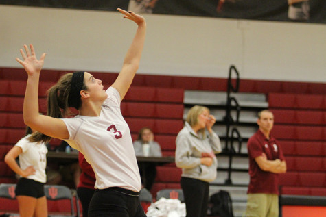 Maddie Jacobi, freshman defensive specialist, serves the ball early in the first set against IU Kokomo on Tuesday, Sept. 29. The Grenadiers lost the match in straight sets.