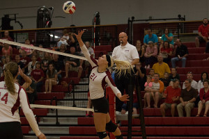 Hannah Joly, freshman outside hitter, goes up for the ball in the Grenadier's match against Point Park. Joly had a team-high 17 kills in the loss.