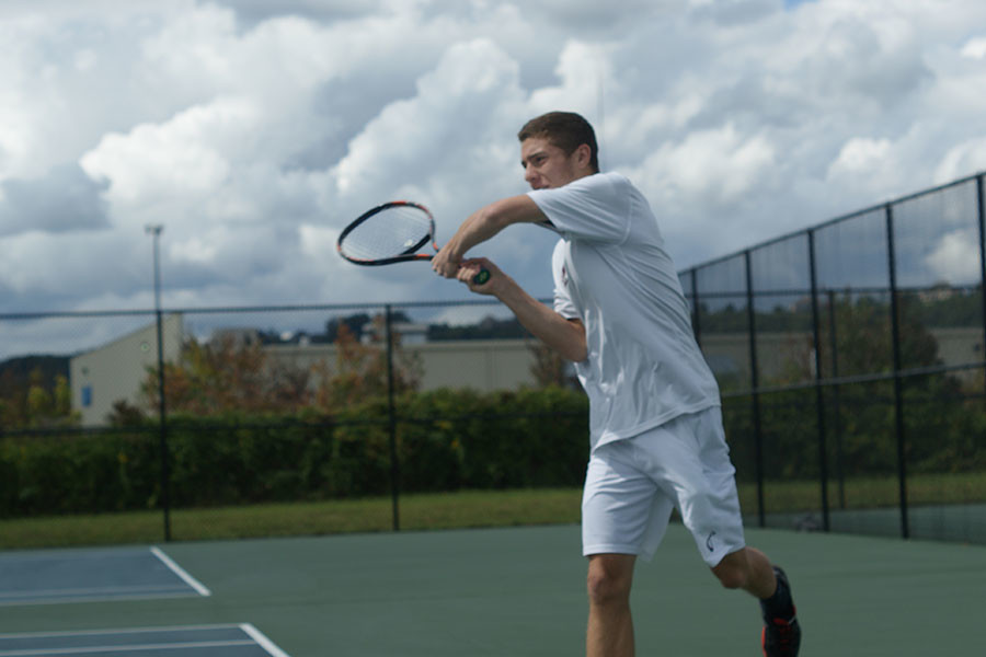 Freshman+Mitch+Staley+after+hitting+the+ball+in+his+match+Saturday%2C+Sept.+12+against+Indiana+Wesleyan.+The+Grenadiers+lost+the+match+7-2.+