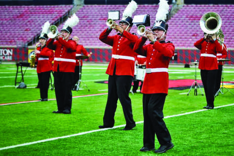 """Members of Southeast Sound perform """"Fuego"""" in exhibition at the Papa John's Cardinal Stadium in Louisville on Friday, June 19."""