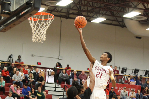 Joe Jackson, sophomore forward, goes up for a layup against St. Catharine on Tuesday, Oct. 27. Jackson finished the game with nine points and six rebounds as the Grenadiers lost by four points in their home opener.