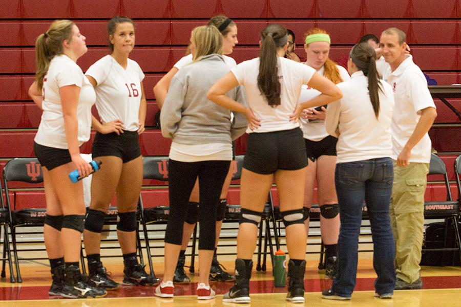 The+IUS+volleyball+team+huddles+up+after+a+set+in+their+match+against+Midway+University+on+Tuesday%2C+Oct.+13.+The+Grenadiers+won+the+match+and+continued+their+win+streak+to+seven+games.