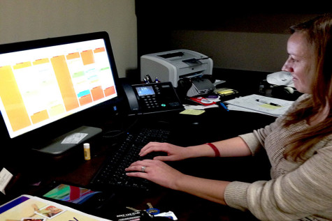 Karen Richie, counselor and care manager in Personal Counseling Services, looks at her scheduled appointments. Richie performs counseling and specializes in helping students access local resources to meet food, clothing, shelter, transportation, medical and mental health needs.