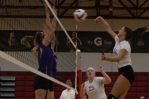 Katie Fischer, junior middle blocker, goes up to spike the ball in the regular season finale against Cincinnati Christian. Fischer had 10 kills against the Eagles. The Grenadiers now will prepare for the KIAC tournament.