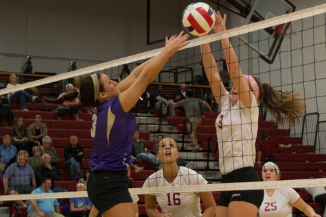 Maddie Jacobi, freshman defensive specialist, goes up for a block against a Cincinnati Christian player in the Grenadiers regular season game on Thursday, Nov. 5.  Jacobi tied for a team-high 11 kills in the loss.