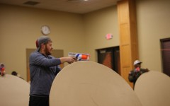 Students engage in combat during Nerf War