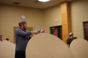 "Alex Williams, history freshman, and Steven Robertson, psychology freshman, coordinate to take down their opponents during the Nerf War. Williams and Robertson won the round by using a technique called ""strategic cover."""