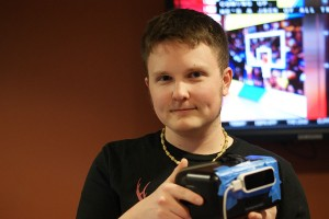 Dallas Flora, informatics senior, shows the Oculus Rift, a virtual reality system, during the Game On 1.5! technology festival. Flora was the guide during the object creation program designed by former IUS students in the informatics program.