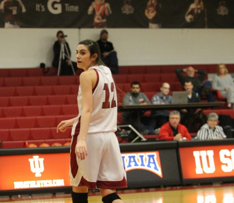 Senior forward Mary Dye looks on as her team takes a tough loss to the Bearcats, 77-69.