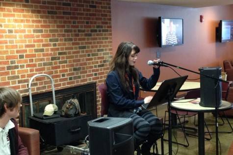 Layla Schmiedler reads a poem to students in The Commons during the SPC Open Mic on  Tuesday, Jan. 19.