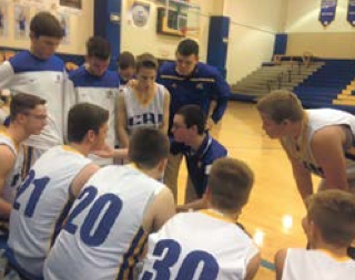 Hayden Casey, secondary education junior, in a huddle with his 8th grade basketball team from a game this season. Casey said that his team won the game, which put them at a record of 9-2 for this season. Photo courtesy of Hayden Casey