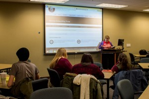 Danielle Devers, biology junior and Success Networking Team coordinator of the IU Southeast chapter of the National Society of Leadership and Success, gives a presentation about SNT meetings before the Juju Chang speaker broadcast begins.