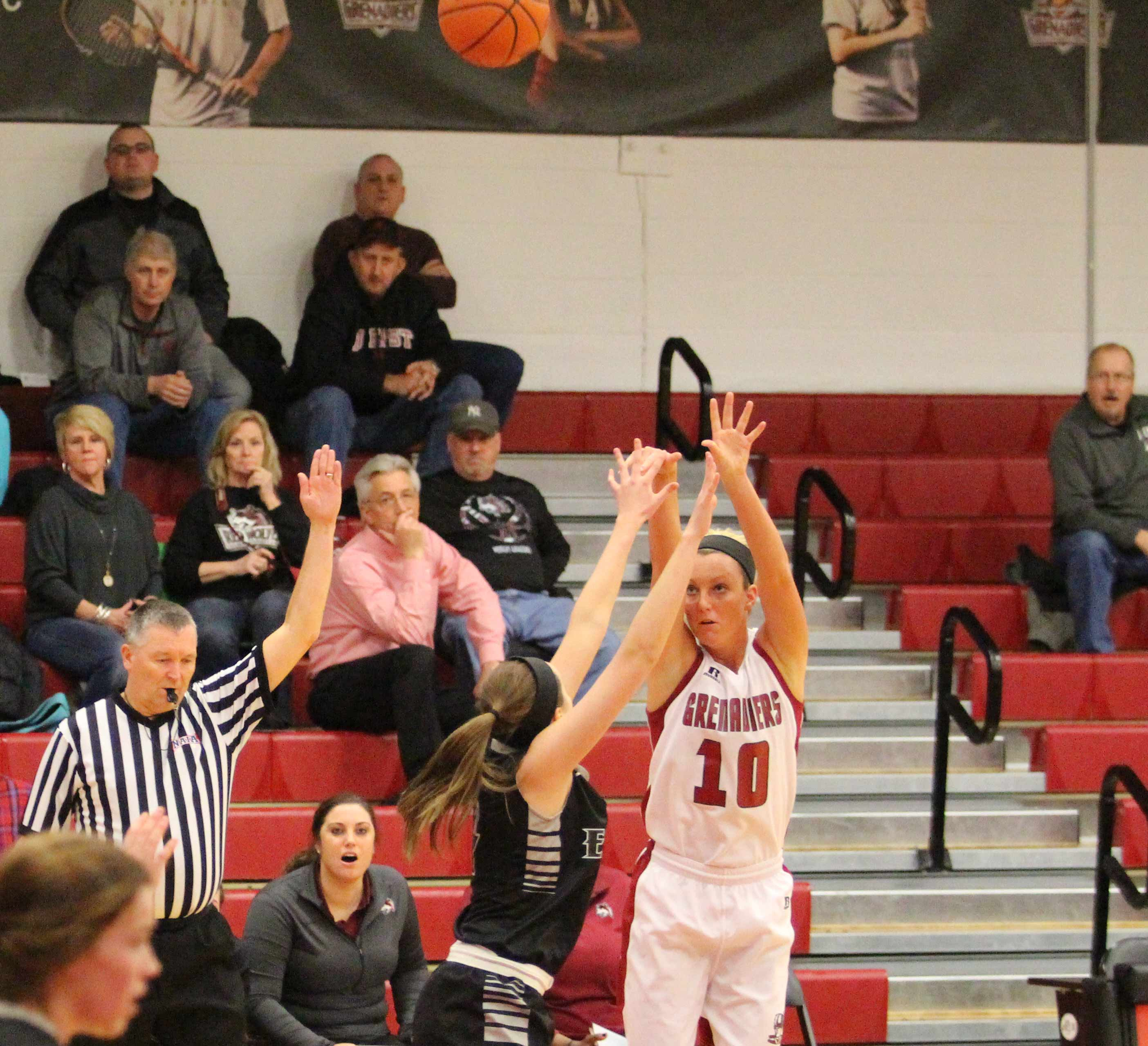 Redshirt freshman Josie Hockman shoots a 3-point basket. The Grenadiers shot 33 percent from behind the arc.