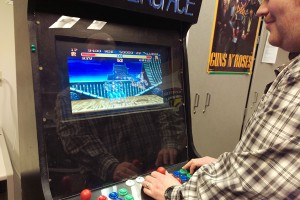 """Lukas DiBeneditto, informatics senior, plays one of the """"Street Fighter"""" games run through the arcade cabinet in the Life Sciences building."""