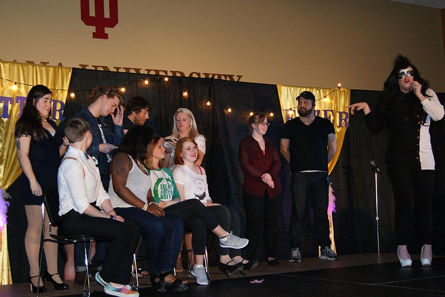"""Audience members participate in """"60-second Drag Queen,"""" a competition to see who could so the best drag makeup on their partner in 60 seconds. Kelly Howard, psychology junior and production team member, stage-manager Nicholas Moore, and emcee Lucy Panic led the game."""