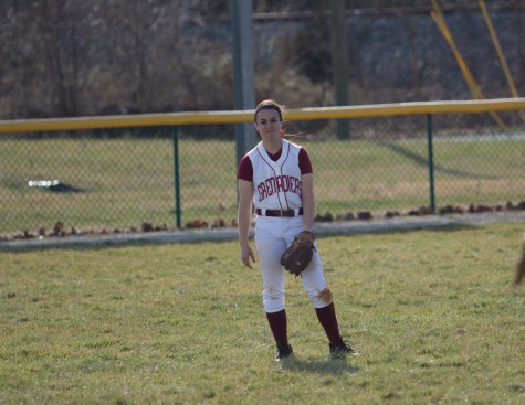 Junior outfielder Brooke Barnett warming up between innings.