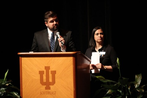 Nicholas Moore, business junior and vice president of the Gay-Straight Alliance, and Veronica Medina, assistant professor of sociology and co-director of the Common Experience, stand at the lectern as Moore reads a question submitted on Twitter for diversity advocate and Pennsylvania State Rep. Brian Sims. Sims' speech was live streamed to the other campuses in the IU system, and anyone who viewed his speech could submit questions to the Common Experience's Twitter account, @common_ius.