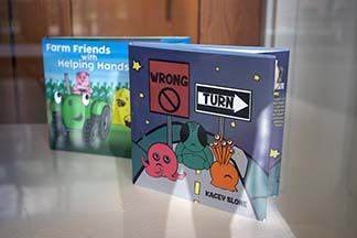 Kacey Slone's book, Wrong Turn, won the graphic design studio award at the IU Southeast Annual Juried Art Exhibition