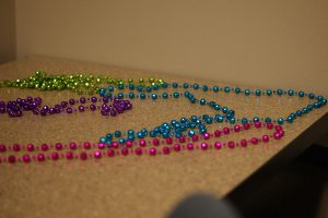 The first 28 participants in the event received necklaces. These are Mardi Gras beads.