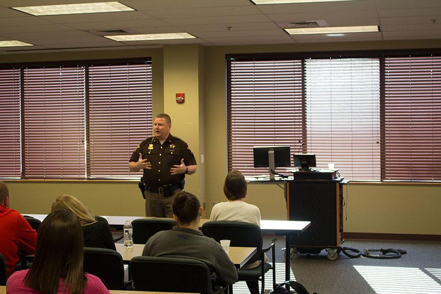 Clark County Sheriff Jamey Noel talks to the students about the importance of finishing their education and what that means for their job searches.