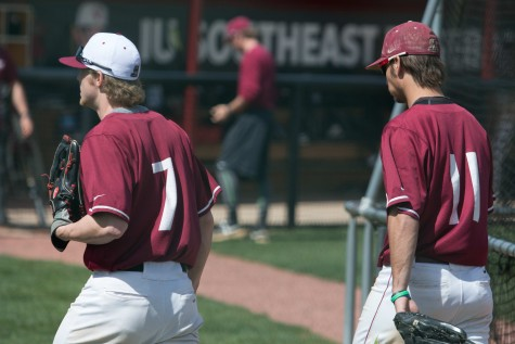 Senior outfielder Logan Coughlin (left) and Adams (right) walking back to the dugout after warming up.