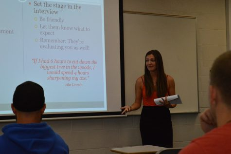 Erin Straub, training and development supervisor at 360 Care and IUS psychology and economics alumna, talks to the class about psychology in the workplace.