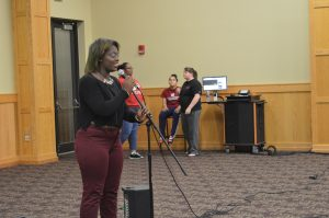 """Martina Andrews, sociology senior, singing an accapella version of Jasmine Sullivan's """"Need You Bad."""" Andrews would go on to be named best singer of the competition."""