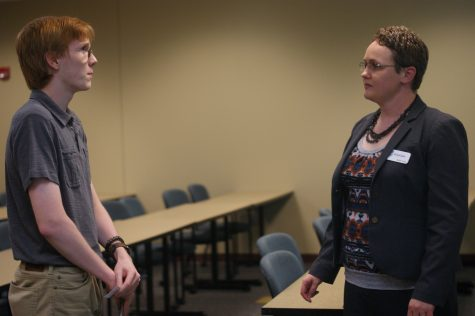 Mahri Irvine, director of campus initiatives, talks with a student about how she became involved with the Indiana Coalition to End Sexual Assault.