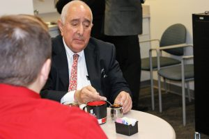 Ben Stein enjoying a cup of tea before answering a few questions for The Horizon. Stein was at IUS for the inaugural First Savings Bank Series to discuss economics in the Ogle Center on Nov. 16 at 6pm.