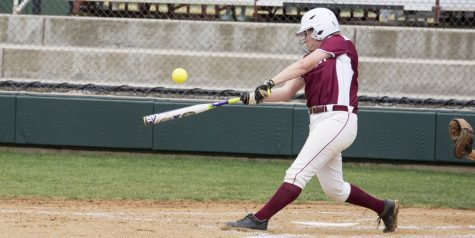 Sydney Seger, freshman, contacts the ball.