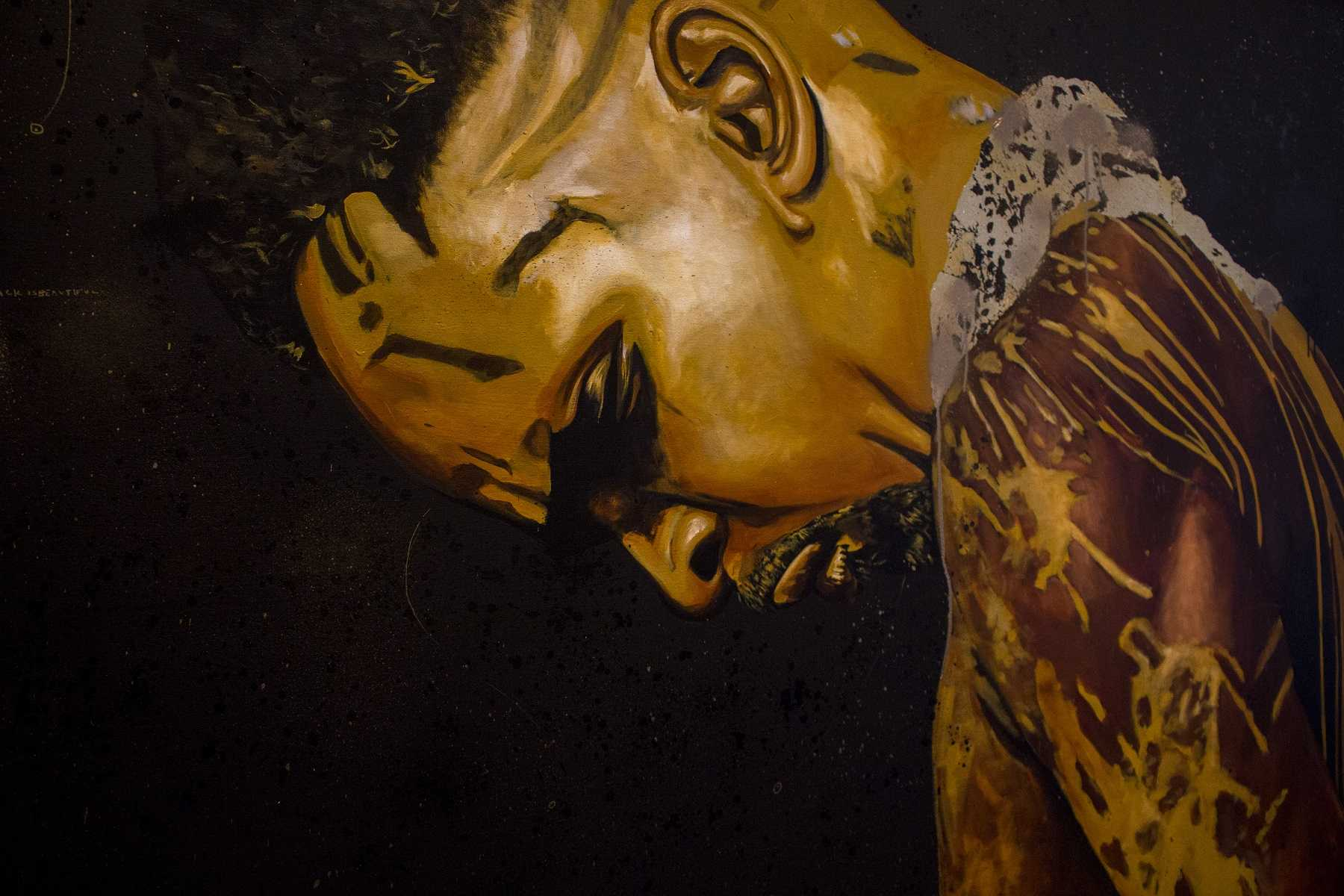 """Black Beauty"" is his name. It is one of many photos that were part of Fahamu Pecou's #BlackMatterLives gallery. This painting is an acrylic, enamel, spray paint and gold leaf on a canvas. According to the Pecou's artist statement, this was supposed to reorient angst and despair experienced by Black America through work that affirms the beauty, strength and resilience of Black people."