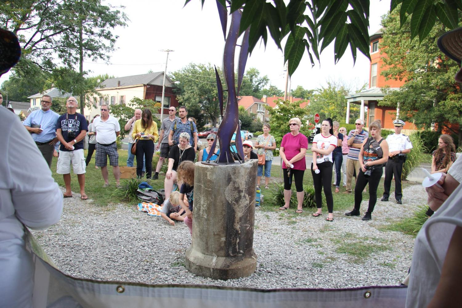 At+the+East+Spring+Street+Neighborhood+Park+in+New+Albany%2C+community+members+and+councilmen+gather+for+a+vigil+hosted+by+the+East+Spring+St.+Neighborhood+Association+%28ESNA%29.+The+crowd+gathered+in+response+to+Charlottesville%2C+VA%2C+where+this+past+weekend+a+woman+was+killed+and+others+injured+when+a+car+drove+into+a+crowd+of+people+protesting+the+rally+of+white+supremacists+and+neo-Nazis.