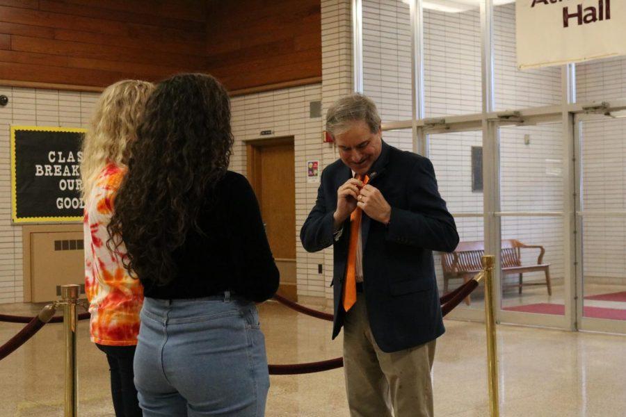 Congressman+John+Yarmuth+receives+a+ribbon+from+Atherton+High+School+seniors+Elena+Nunez+and+Hailey+Streble.