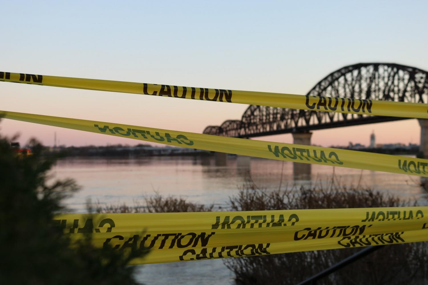 Hazard tape is put up in an effort to keep curious onlookers at bay and out of harms way.