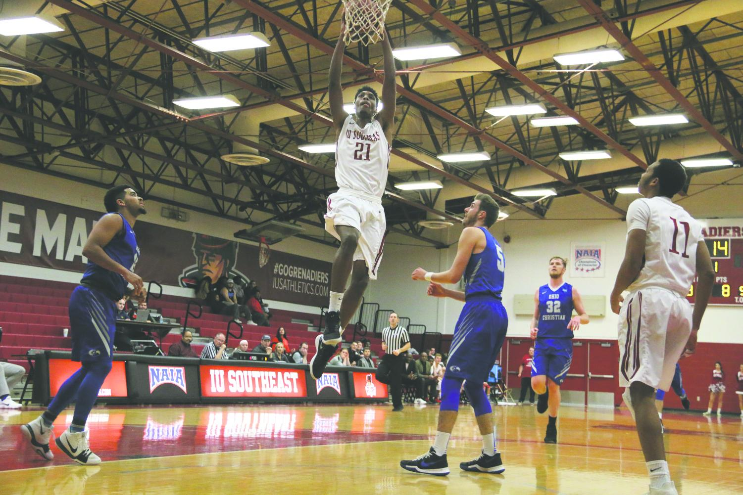 Joe Jackson, senior forward, jumps toward the basket for a dunk against Ohio Christian. Jackson is one of the nation's best defensive players, leading NAIA Division II in both total blocks and blocks per game.