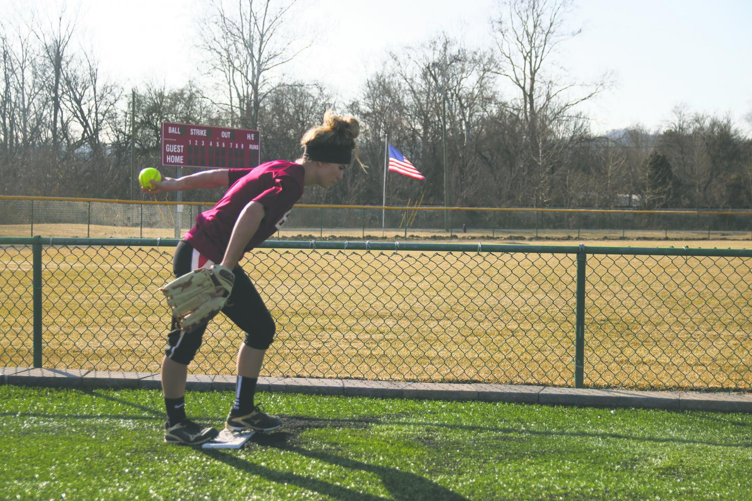 Morgan Keefer, junior pitcher and outfielder, winds up for a pitch at practice. Keefer is part of the group of returning players Coach Witten hopes to lead the Grenadiers this year.