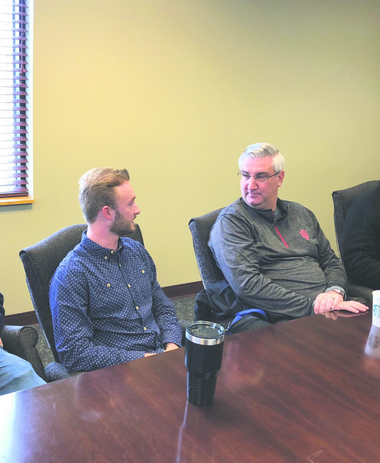 Roger Howard, chairman of the Federation of College Republicans, talks with Indiana Gov. Eric Holcomb during a meeting at IU Southeast on Saturday, April 7. Photo courtesy of Roger Howard.