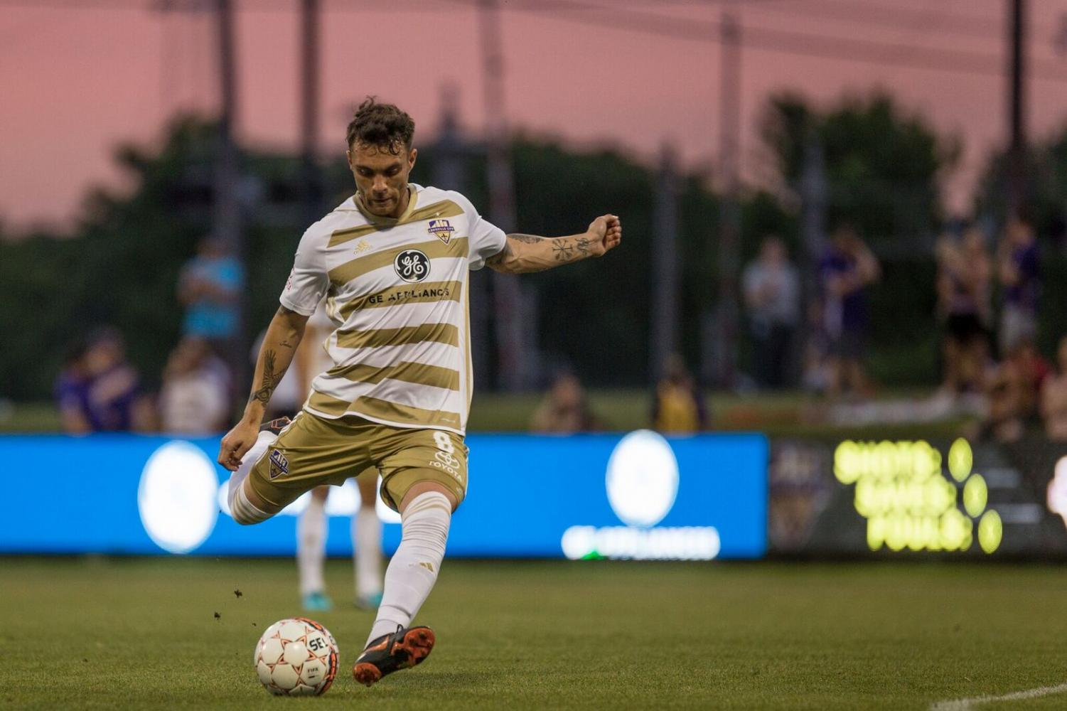 "Louisville City forward, Cameron Lancaster, takes a free kick during a 6-0 rout of the Richmond Kickers. The club is hosting ""College Night"" for students on Aug. 31."