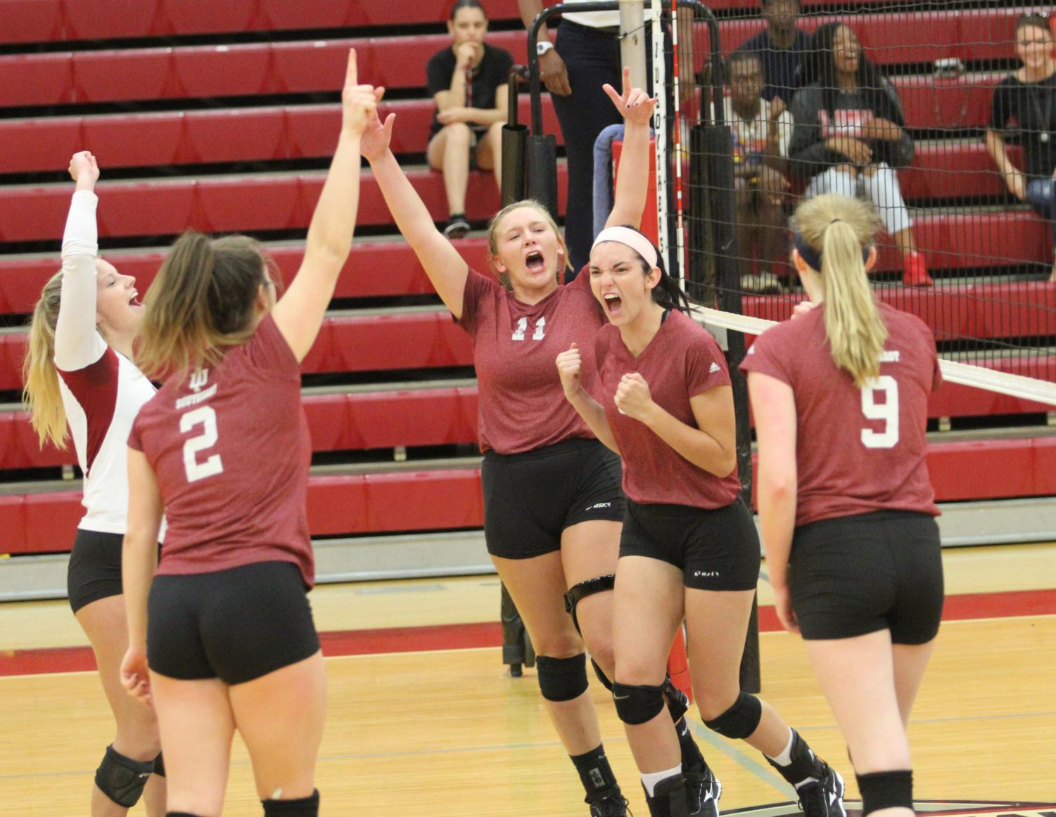 The volleyball team celebrates a point during a home match against Cincinnati Christian University last season. The Grenadiers home opener will fall on Thursday, Aug. 30, at 7 p.m. against St. Mary-of-the-Woods.