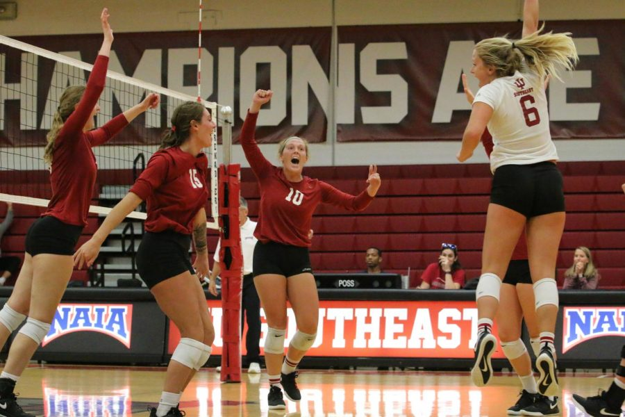 The+Grenadier+volleyball+team+celebrates+after+taking+the+third+set+against+the+defending+national+champions+from+Lindsey+Wilson+College.+The+Grenadiers+would+go+on+to+lose+the+match+3-1.+Photo+by+Tamar+Kelly.