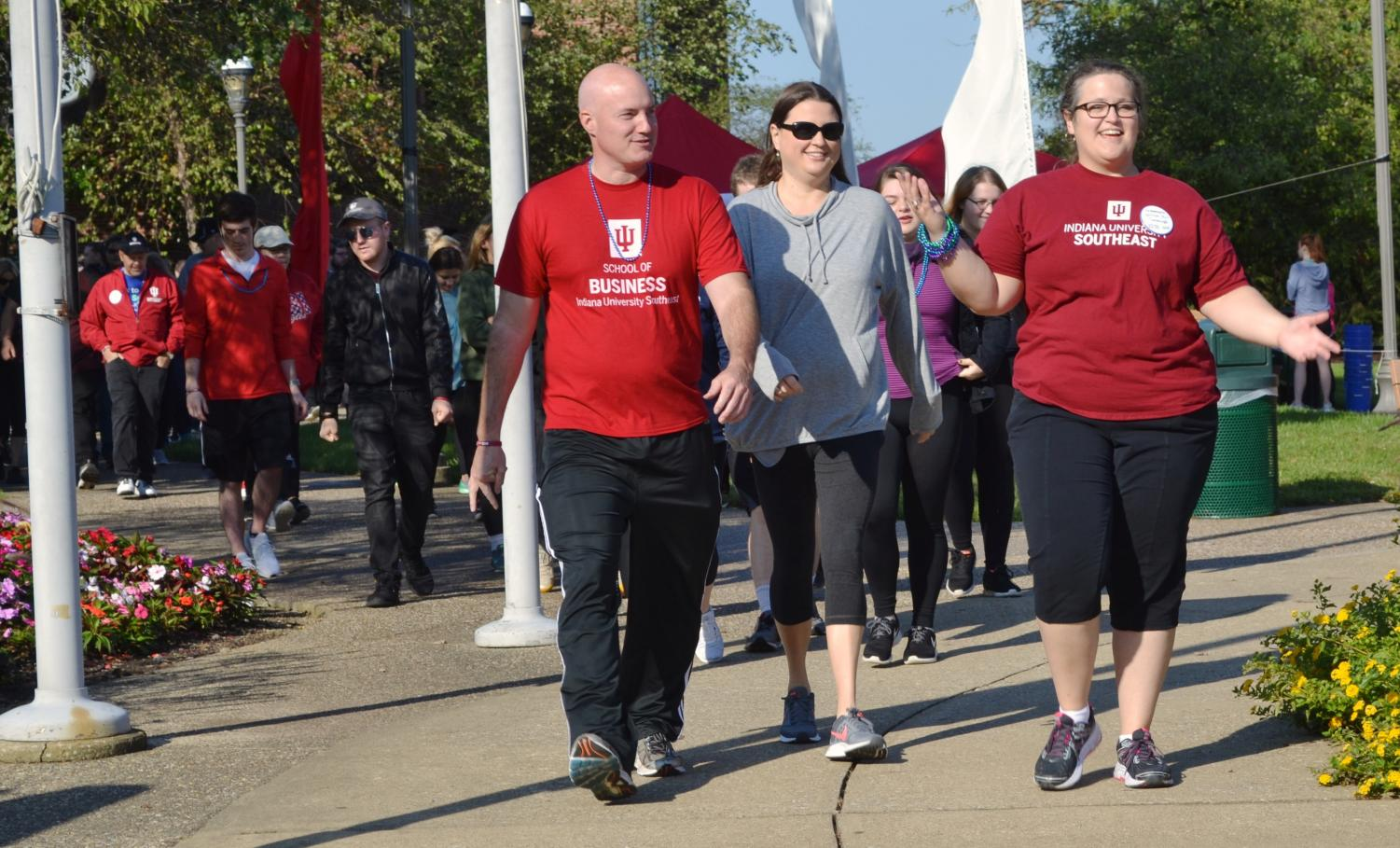 Students, faculty and community members walk in the Out of the Darkness walk to prevent suicide.