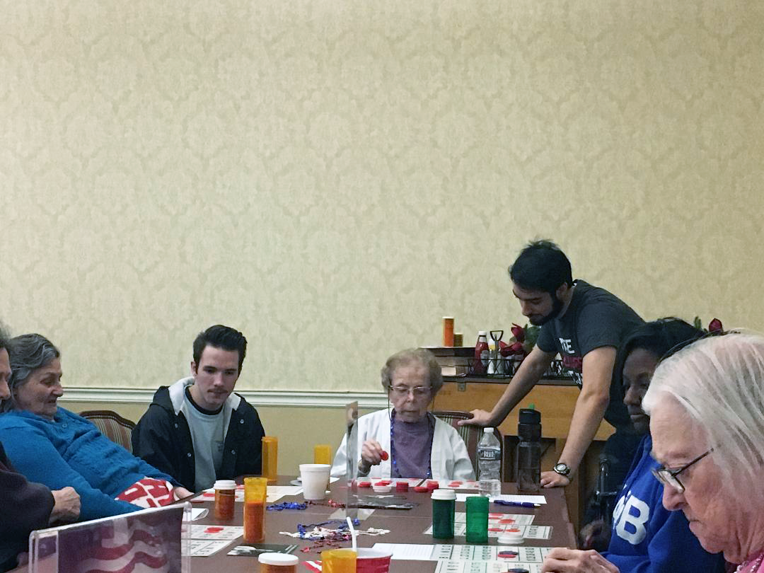 IUS+students+Bryce+Alford+and+Bassem+Debbabi+assisted+residents+in+playing+bingo.